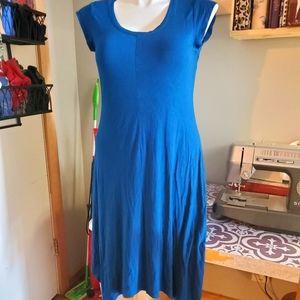 Blue cap sleeve dress with sharkbite hem